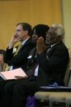 From left to right: A.C.E. President David Woodward, Lola Poisson and Ambassador Raymond Joseph