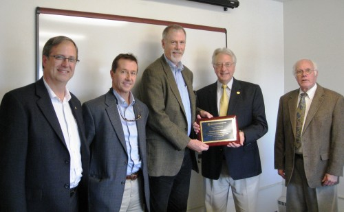 presents plaque of appreciation for its partnership with ...