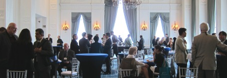 Senior Director Paul Kwilinski, far left, and Senior Vice President Sam Shepherd, far right, host the reception in the lavish Renaissance St. Louis ballroom.