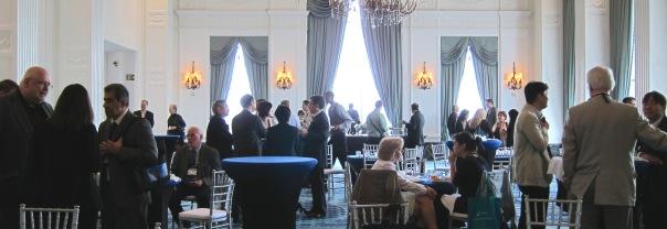Senior Director Paul Kwilinski, far left, and Senior Vice President Sam Shepherd, far right, host the reception in the lavish Renaissance St. Louis ballroom.