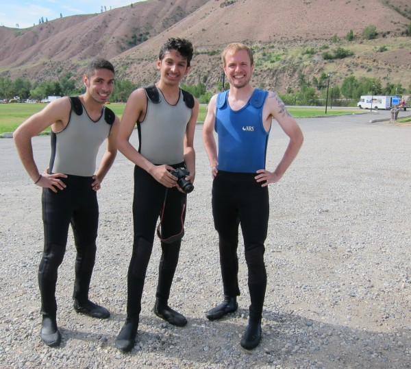 Smiles before miles on the river: A.C.E. Operations Analyst and ECO Club manager Ben Kantner, right, stands with Mohammad and Abdulrahman.