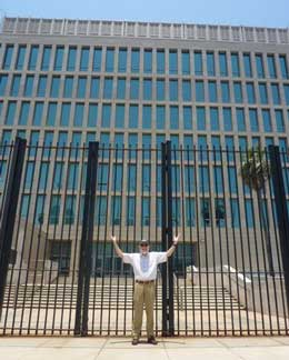 URI Oceanography Dean Bruce Corliss poses in front of the U.S. Embassy in Havana on the day it opened, July 20. (Photo by Nancy Stricklin)